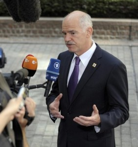 Greece's Prime Minister George Papandreou attends an interview as he arrives at an European Union Heads of States summit in Brussels, June 17, 2010.   REUTERS/Eric Vidal  (BELGIUM - Tags: POLITICS BUSINESS)
